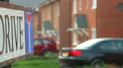 Pull focus from street sign to street Stock Footage