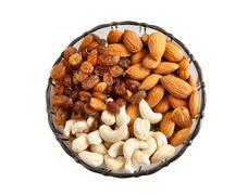 Raisins almonds and cashews in glass bowl Stock Photos
