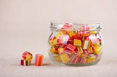 Glass jar full of tutti-frutti sugar candies Stock Photos