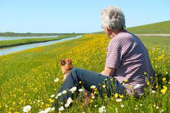 Man and dog on dutch wadden island texel Stock Photos