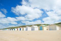 Blue beach huts at texel Stock Photos