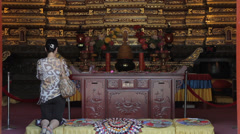 Buddhists pray inside the Temple - stock footage