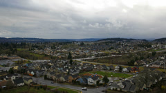 Traffic and Clouds Time Lapse Over Homes in Happy Valley Oregon 1080p Stock Footage