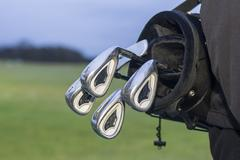 Golfclubs carried in a golfbag Stock Photos