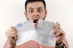 tearing euros - stock photo