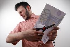 cutting funds - stock photo