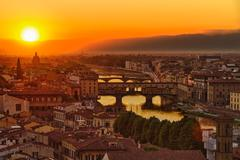 Florence, Arno River and Ponte Vecchio at sunset, Italy Stock Photos