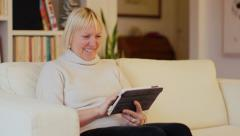 Senior woman at home, using ipad - stock footage