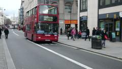 London bus passing by Stock Footage