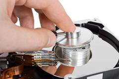 Computer hdd and hand with stethoscope Stock Photos