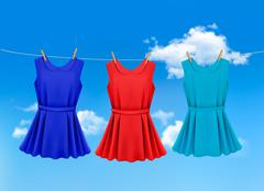set of colored dresses hanging on a clothesline on a sunny day. vector illust - stock illustration
