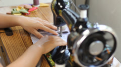 Retro style manual sewing machine working - stock footage