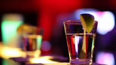 Two Shot Glasses getting picked up Stock Footage