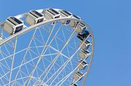 Stock Photo of ferris wheel in the park with clear blue sky and empty space for some text