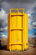 sloped bottom oil storage tank - stock photo