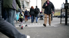 Crowd crossing street on parliament square two Stock Footage