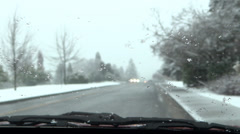 Winter Road - 10 - Traffic Througn Windshield With Moving Wipers In Snowfall - stock footage