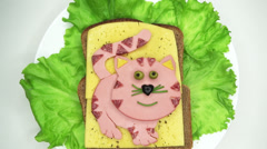 Creative sandwich with cheese and salame cat shape Stock Footage