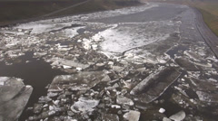 beginning of  ice drift on spring  river in city - stock footage