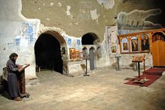 Eremite praying in david gareja monastery, georgia Stock Photos