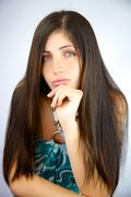 Stock Photo of woman with amazing silky beautiful long hair looking