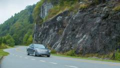 Family Sedan Driving on Blue Ridge Parkway Past Stone Wall Stock Footage