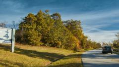 Car Entering the Blue Ridge Parkway with Autumn Colors Stock Footage