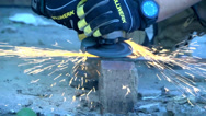Stock Video Footage of Tradesman using a Grinder