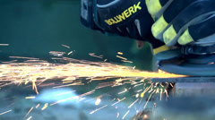Tradesman using a grinder in Slomo Stock Footage