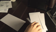 Stock Video Footage of Male Hands Writing Address On An Envelope Above-Shot