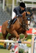 Angelica Augustsson in action rides horse Mic Mac Du Tillard - stock photo