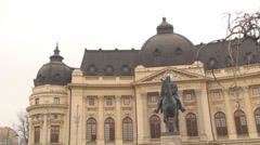 University Foundation And The Statue Of Carol The First In Bucharest Pan-Shot - stock footage