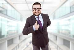 Young silly business man going thumb up Stock Photos