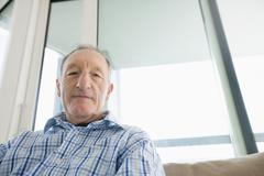 Stock Photo of portrait of senior man relaxing in living room