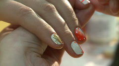 Nail polish on manicure is painted on her fingernails Stock Footage