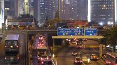 Hong Kong Wanchai downtown Traffic at dusk Stock Footage
