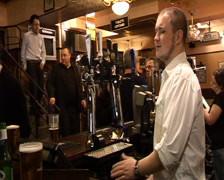 Bartender serving bankers in London City Pub Stock Footage