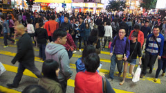 Hong Kong rush hour crowds downtown busy commuters zebra cross Causeway Bay Stock Footage