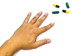 Drug abuse concept - passive hand on white background Stock Photos
