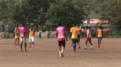 Youths playing football in Ghana Stock Footage