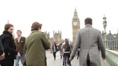 People walking accross westminster bridge 1B Stock Footage