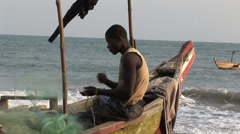 Africa: Fisherman at work in Ghana Stock Footage