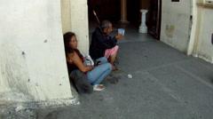 Blind Beggar receives alms at Church Door Stock Footage