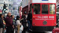 Hong Kong Wanchai downtown passengers getting on tram China Asia - stock footage