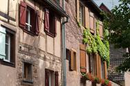 Stock Photo of street with half-timbered medieval houses in eguisheim village along the famo