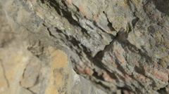 Rock climbing protection failing under presure  slow motion Stock Footage