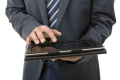 Businessman using touch pad, close up shot on tablet pc, isolated Stock Photos