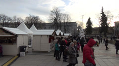 human uproar in street to white christmas decorations food fair - stock footage