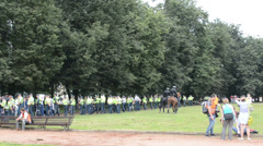 Row police officers along park take their positions in event Stock Footage