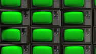Vintage tv stack green screen perspect pan across Stock Footage